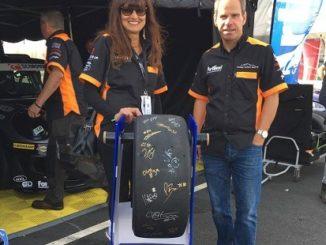 Jasmine Jones and Derek Evans with the tyre