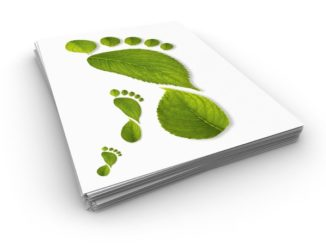 Carbon Neutral Green Footprint image of leaves printed on white paper