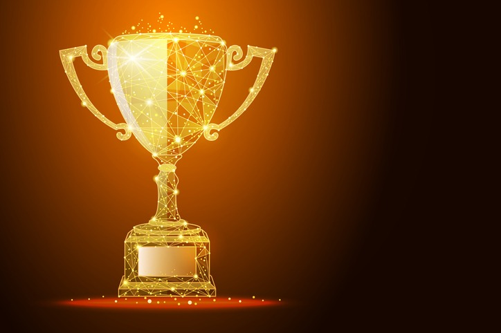 Low poly illustration of the winner cup a golden dust effect, with space for your text
