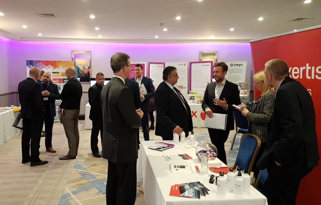 People attending Dealer Support Live and talking by the Exertis Supplies Stand.
