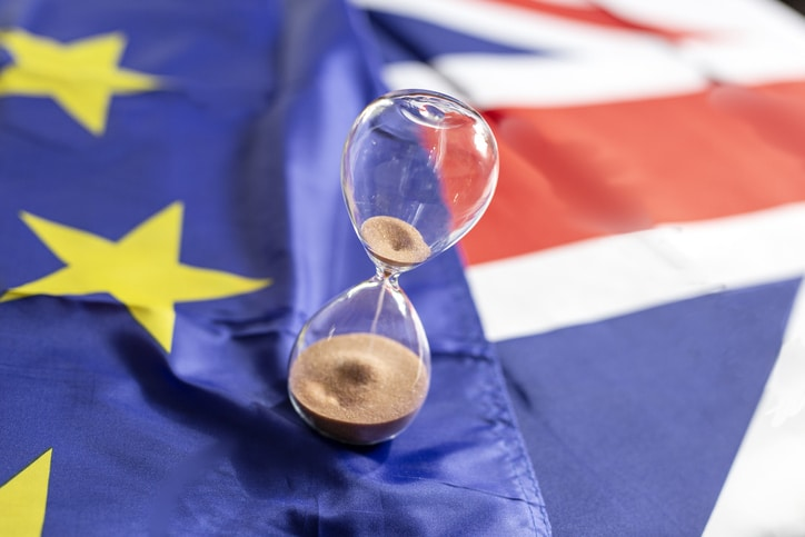 Out of time for brexit, hourglass over european and britain flag