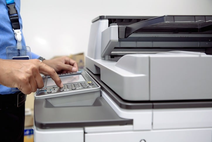Businessman press button using photocopier or printer is office work tool equipment