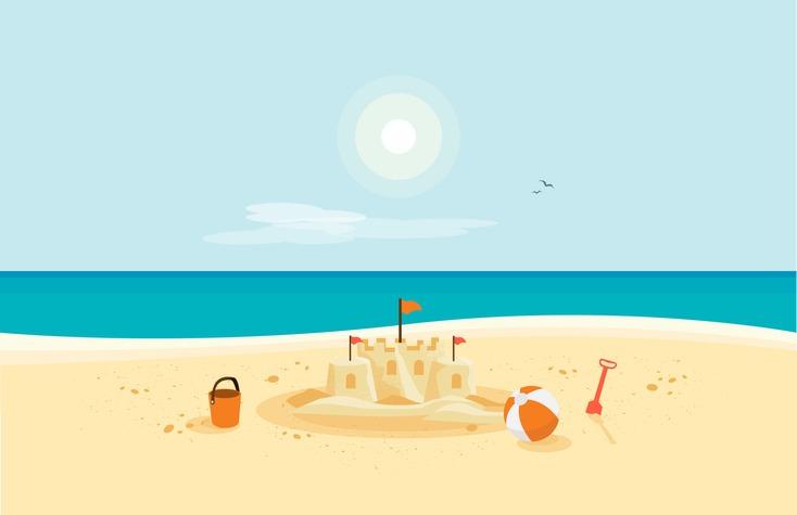 Sand Castle on Sandy Beach with Blue Sea Ocean and Clear Summer Sunny Sky
