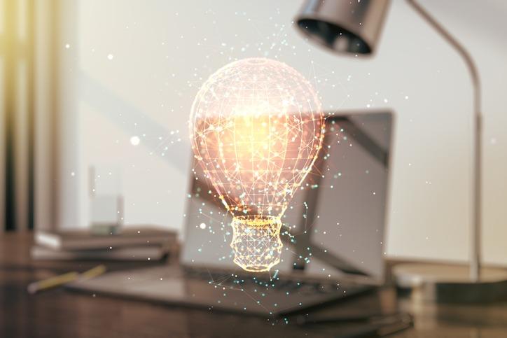 Creative light bulb illustration on modern computer background, future technology concept. Multiexposure